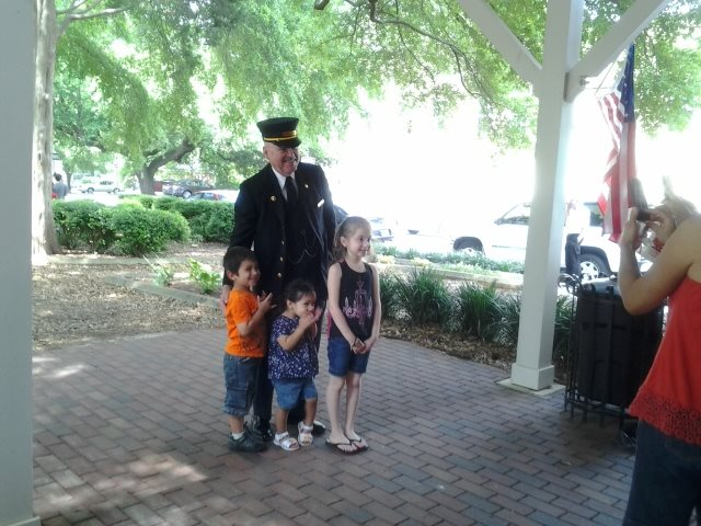 Conductor Winslow posing for pictures with children